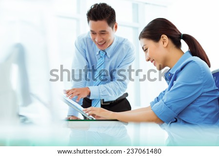 Vietnamese business team discussing financial document - stock photo