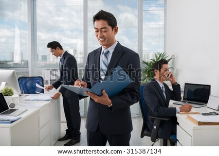Vietnamese businessman and his clones working in the office