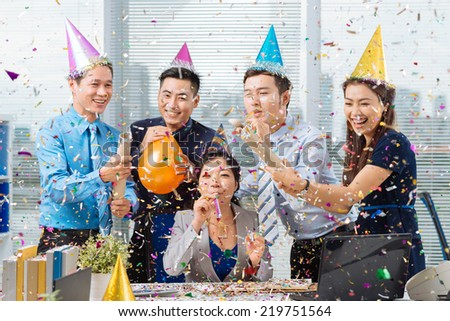 Vietnamese coworkers having celebration in the office - stock photo