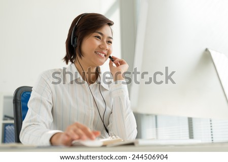 Vietnamese customer service representative working in the office - stock photo