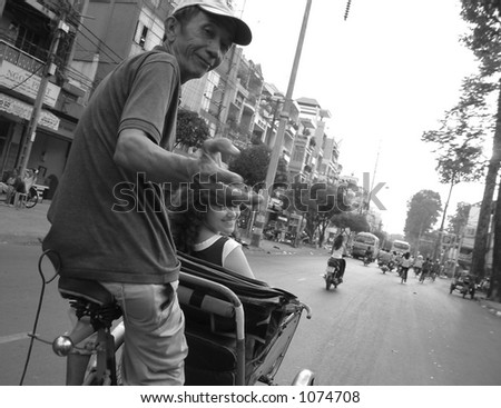 Vietnamese cyclo rider in Ho Chi Minh - stock photo