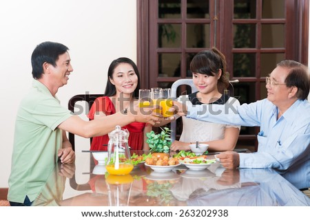 Vietnamese family having dinner at home