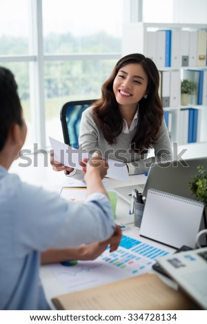 Vietnamese financial adviser consulting client - stock photo