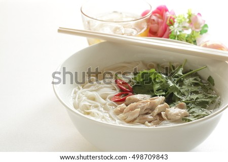 Vietnamese food, chicken on rice noodle with iced tea
