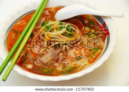 vietnamese food: closeup of satay beef noodle soup - stock photo