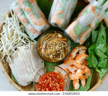 Vietnamese food, goi cuon is street food, roll that delicious, wrapped from shrimp, pork, vegetables, bun in rice paper, with accompaniments:  sauce, chili,  another name: salad roll, soft roll..  - stock photo