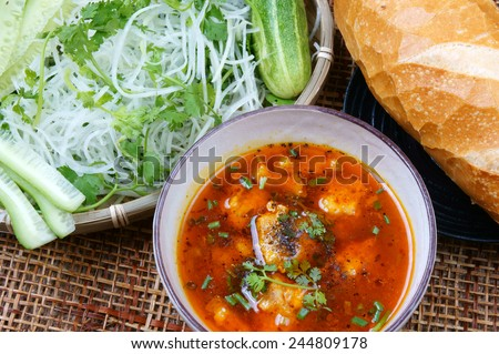 Vietnamese food, meatball, make from ground meat, delicious, popular street food or Vietnam meal, season with vegetable as: cucumber, scallion, papaya  and bread. This dish process by Dalat style - stock photo