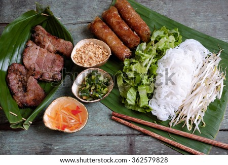 Vietnamese food, spring roll or cha gio, roast meat , a delicious fried food, eat with bun, salad and fish sauce, this also rich calories, cholesterol, fatty food, popular Vietnam eating