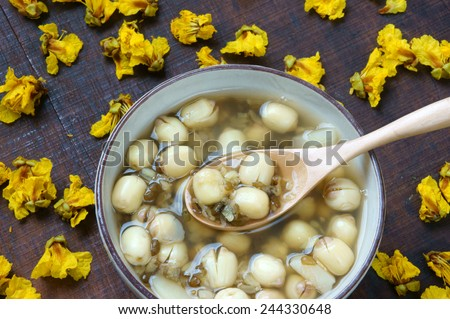 Vietnamese food, sweet lotus seed gruel, ingredients: lotus bean, mung bean, water chestnut and sugar candy. this Vietnam dish for dessert or snack, very delicious, tasty, nutrition, make sleep well - stock photo