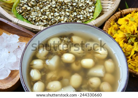 Vietnamese food, sweet lotus seed gruel, ingredients: lotus bean, mung bean, water chestnut and sugar candy. this Vietnam dish for dessert or snack, very delicious, tasty, nutrition, make sleep well