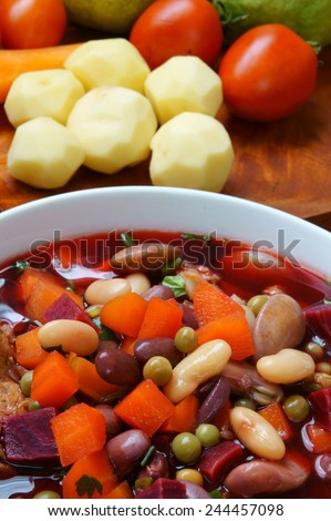 Vietnamese food, vegetable soup, fresh ingredients: potato, green pea, carrot, red bean, white bean, pork pone, raw material stew in water, season with scallion, is popular dish in Vietnam meal - stock photo