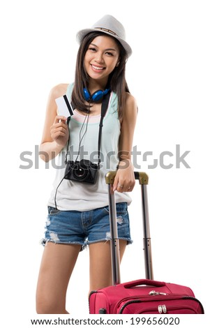 Vietnamese girl going on vacation with her credit card - stock photo