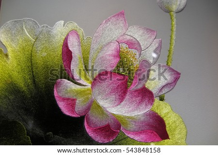 Vietnamese Lotus flower silk embroidery as a main element of the traditional Vietnamese embroidery pictures
