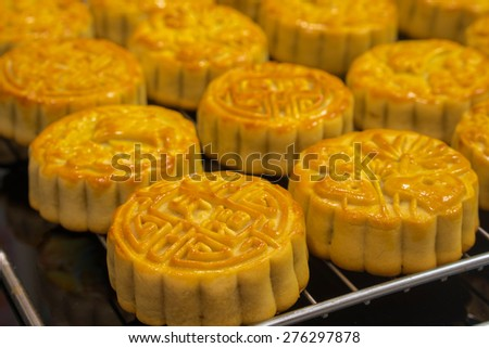Vietnamese mid autumn festival cake. Mooncakes are traditional pastries eaten during the Mid-Autumn Festival. The festival involves family getting together to share mooncakes while watching the moon - stock photo