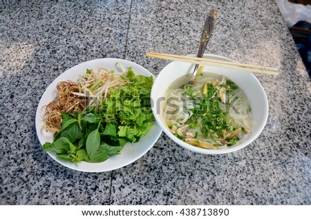 Vietnamese noodle soup with chicken vietnam style called Pho - stock photo