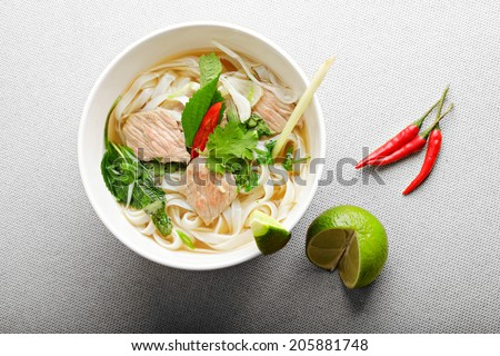 Vietnamese pho bo soup on a beaf broth above view - stock photo