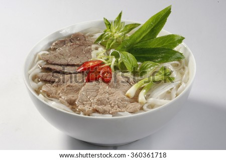 Vietnamese Pho , rice noodle soup with sliced rare beef