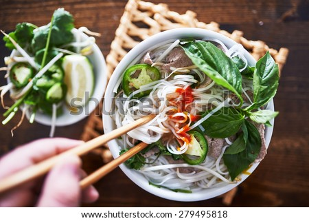 vietnamese pho with spicy sriracha sauce shot top down - stock photo