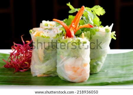 Vietnamese salad rolls with shrimps, chicken, herbs, green papaya and sour mango - stock photo