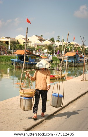 Vietnamese sellerwoman on  the street, Hoi An, Vietnam - stock photo