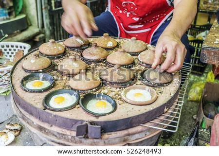 Vietnamese street food, banh can is one of pancake with egg, fish, mango, a famous Vietnam dish at Lien Huong, Binh Thuan, cake process from rice flour