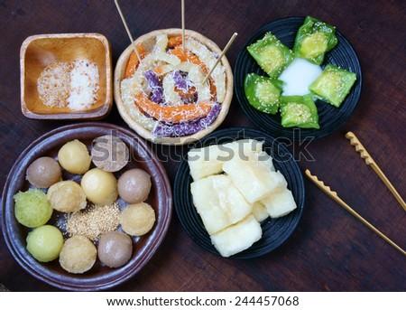 Vietnamese street food, sweet cake, popular snack at Vietnam,  sponge cake, silkworm cake, su se, manioc steam with coconut milk, season with seasame salt - stock photo