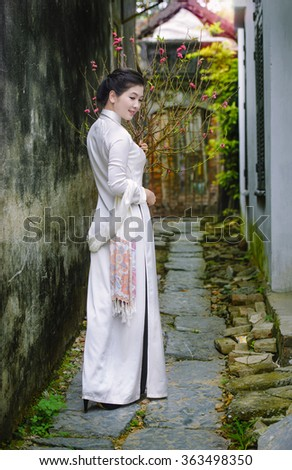 Vietnamese traditional clothes in spring , Chinese happy new year  - stock photo