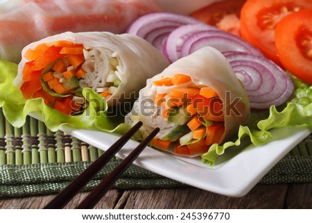 Vietnamese vegetarian vegetable spring rolls on a plate macro. horizontal  - stock photo