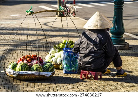 Vietnamese vendors selling fruit and vegetables at Dalat city market, Vietnam