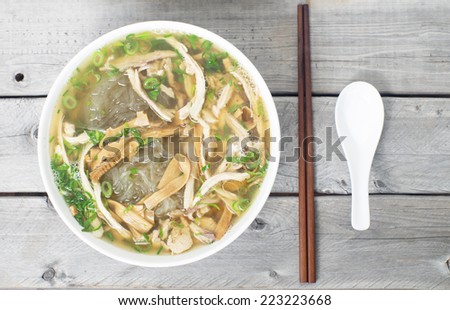 Vietnamese vermicelli chicken and bamboo shoots soup - Mien Man Ga - Tet traditional meal - stock photo