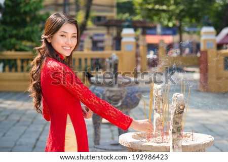 Vietnamese woman holding an incense stick
