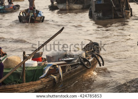 Vietnamese  wood boat with steaming pots on Cai Rang floating market in the Mekong Delta of Can Tho. Sunset light