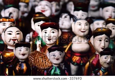 Vietnamese wooden puppets - stock photo