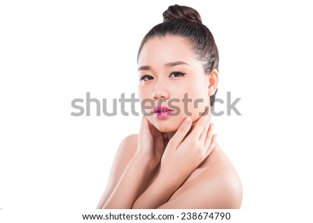 Vietnamese young brunette with perfect skin looking at the camera - stock photo