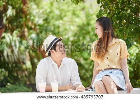 Vietnamese young couple enjoying date in the park