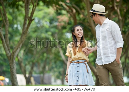Vietnamese young couple having date in the park