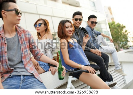 Vietnamese youths spending their time in the street - stock photo
