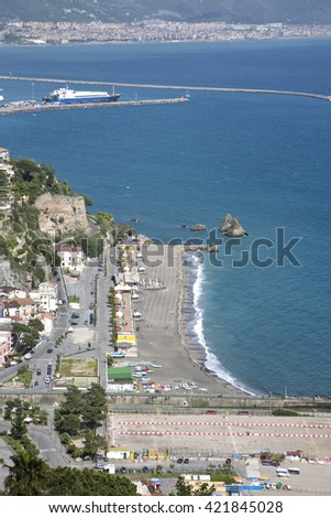 Vietri sul mare beach with Salerno harbor on the background