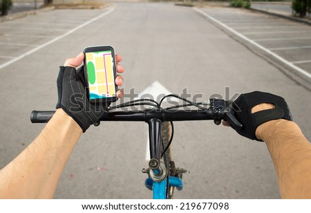 View a map on the mobile phone on a city bike and search GPS coordinates - stock photo