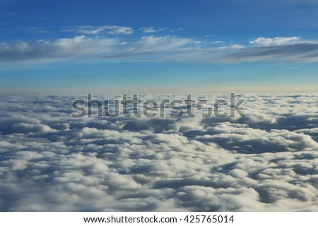 View above the clouds from an airplane window