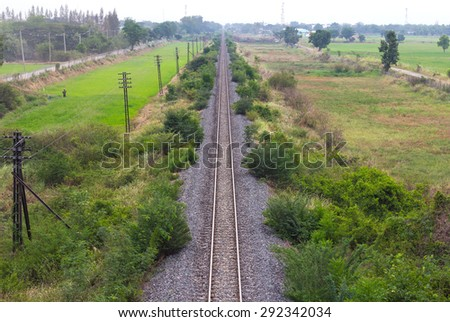 View above the rails straight ahead near the residence of Agriculture Rural Thailand. - stock photo