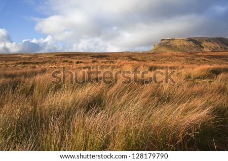 View across moor leading to Pen-y-Ghent in Yorkshire Dales National Park - stock photo