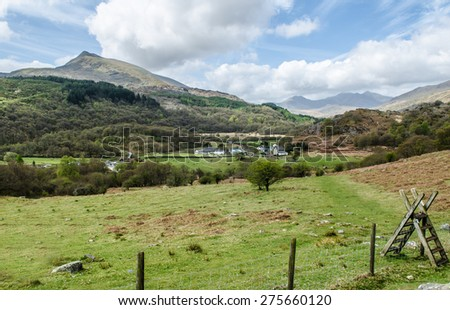 View across Snowdonia Valley to Capel Curig and Snowdon - stock photo