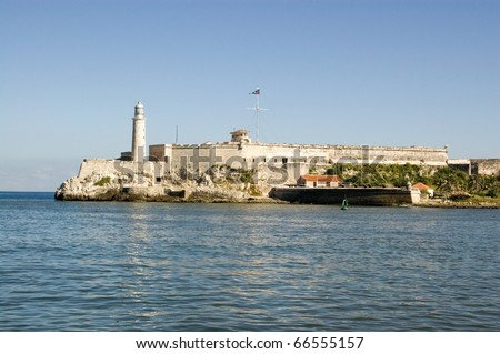 View across the mouth of Havana Harbor towards the lighthouse of Morro Castle, Cuba.