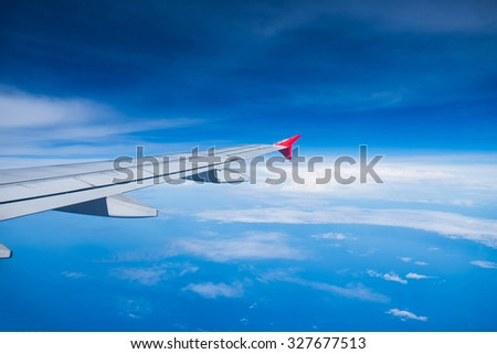 View airplane cloudy blue indigo sky
