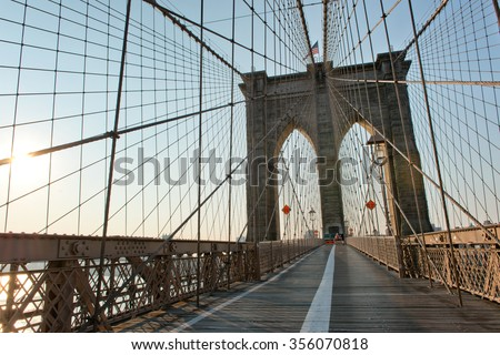 View along Brooklyn Bridge pedestrian walkway giving a view of the tower and steel suspension cables, New York City