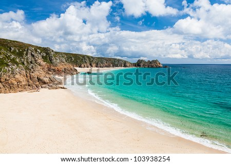 View along the golden sandy beach at Porthcurno Cornwall England UK - stock photo