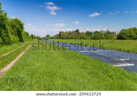 View along the green meadows at Dreisam river, Freiburg, Germany - stock photo