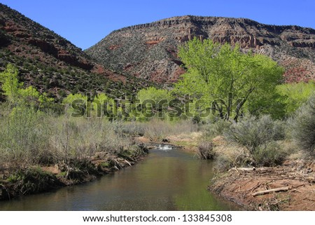 View along the Jemez River in New Mexico with cottonwood trees - stock photo