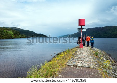 View and people from Fort Augustus over famous Loch Ness in Scotland  - stock photo